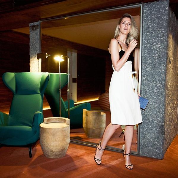 """I'm wearing a black-and-white Louis Vuitton midi dress, a blue Louis Vuitton Twist MM Bag(£2300), and AquazzuraPina Colada Patent Heels(£620)."""
