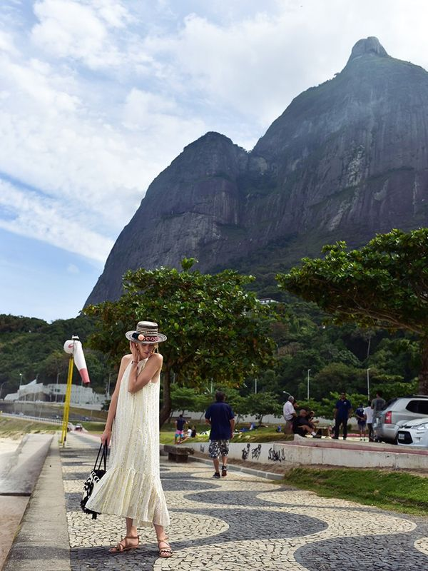 """""""Taking a little stroll to explore my beautiful surroundings, wearing a Rio-inspired outfit with a breezy Tibi Lurex Fil Coupe Chase Dress (£475), a Yosuzi Tulum Hat (£260), and..."""