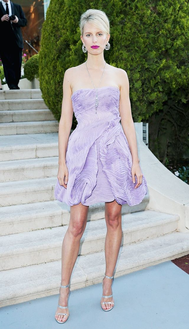 For this year's amfAR gala, Karolína Kurková styled a lavender strapless cocktail dress with metallic Tamara Mellon heels.