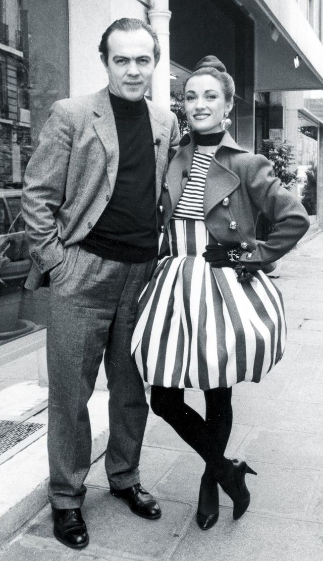 1980s: Jane Seymour next to designer Christian Lacroix in a striped bubble dress.