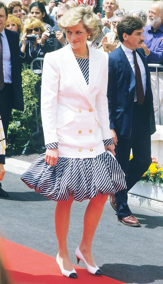 1987: Princess Diana styled a white double-breasted blazer over her bubble dress in Cannes.