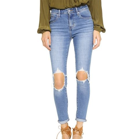 721 High Rise Distressed Skinny Jeans