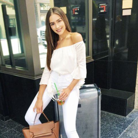 Olivia Culpo fashion style: Celinebag, MajorelleThistleberry Top, Paige Jeans, Stuart Weitzmanboots