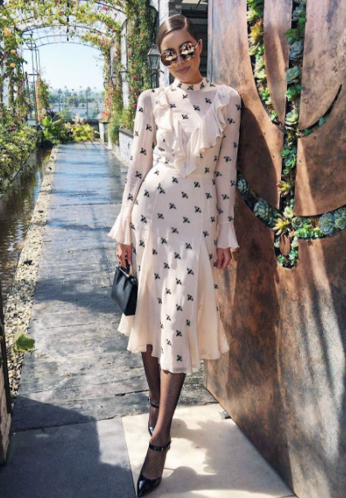 Olivia Culpo fashion style: Temperley London dress, Strathberry Nano Tote