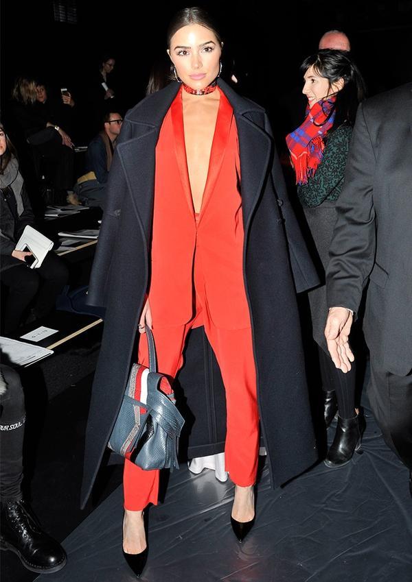 Olivia Culpo fashion style: Baja East trouser suit, Tod's bag