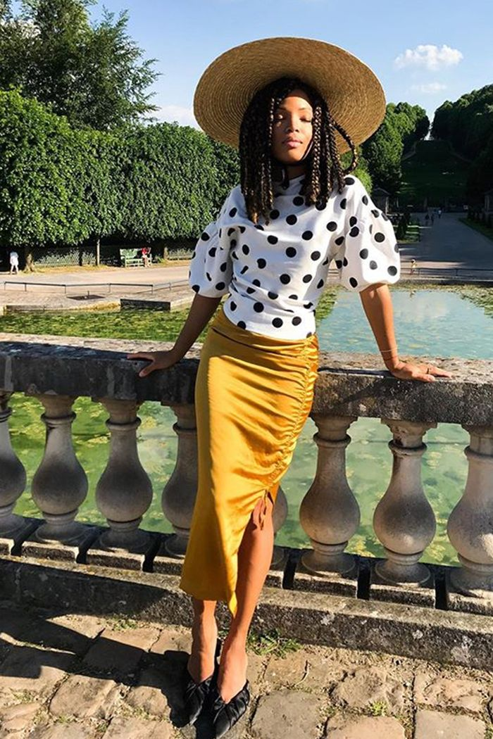 What to wear to a city wedding: ellie wears a polka dot H&M top and yellow skirt