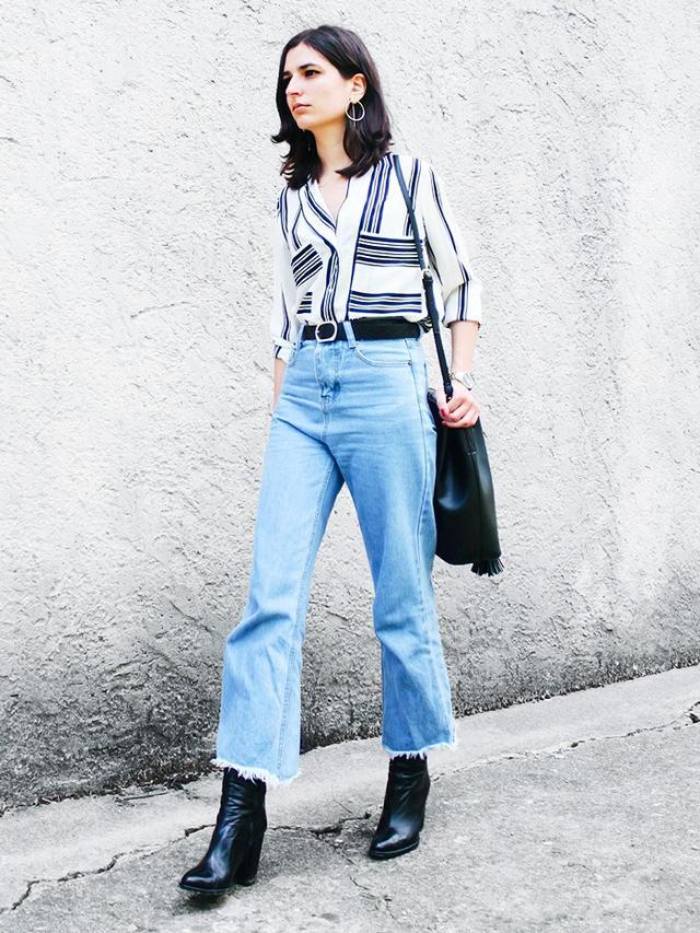 On Aria Di Bari: Zara boots.