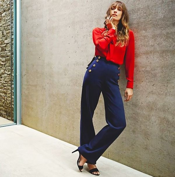 On Caroline de Maigret: Karen Millen pants and top.