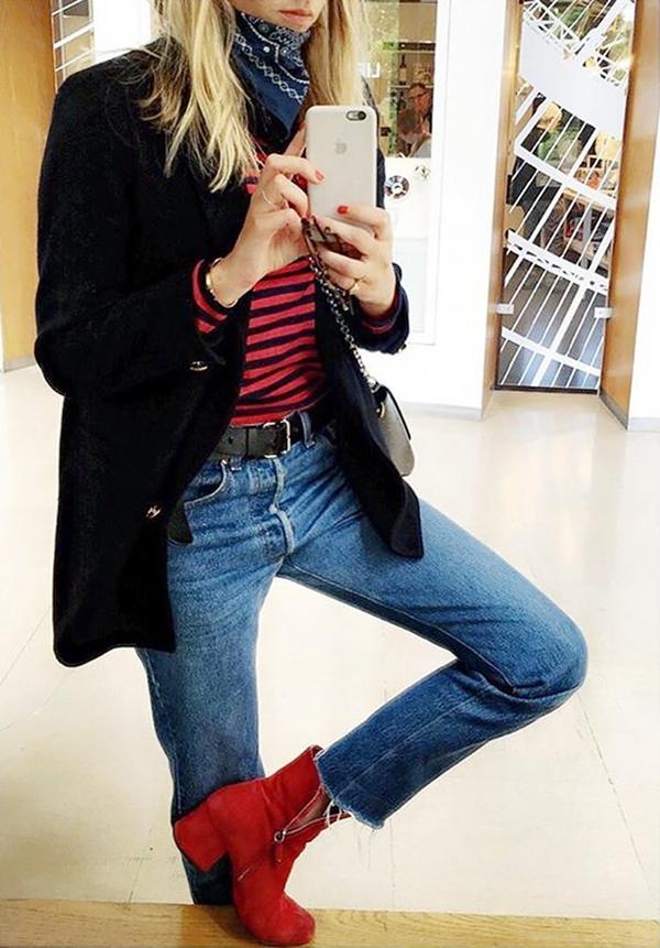 On Camille Charrière:Mads Nørgaard top; Ganni blazer; Levi's jeans; Dorateymur boots.
