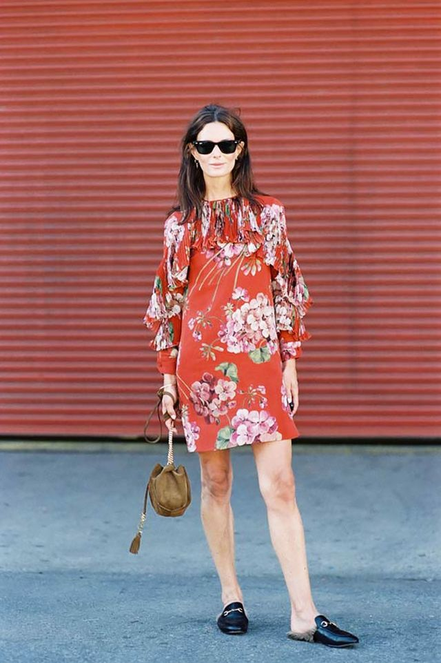 On Hedvig Opshaug: Gucci Floral-Print Silk-Georgette Mini Dress ($2900) and Princetown Leather Slippers ($995).