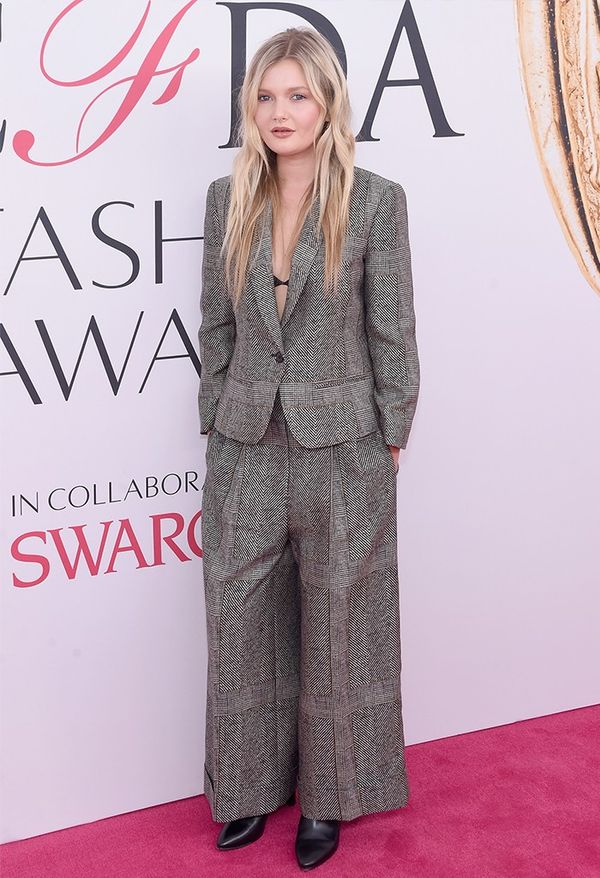 Style Notes: The tweed fabric of Sophie Kennedy Clark's heavy trouser suit means that peek of bralette is completely unexpected but totally right.