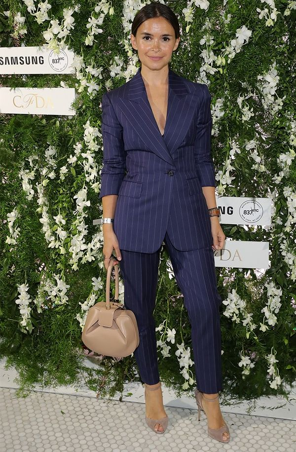 Style Notes: Pinstripes read busineswoman, but a deep-V neckline says otherwise…