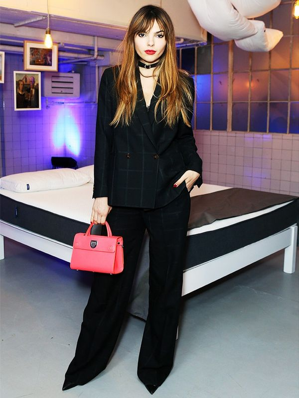 Style Notes: Super-blogger Doina Ciobanu avoids the corporate look by pairing her suit with a choker and bold bag.