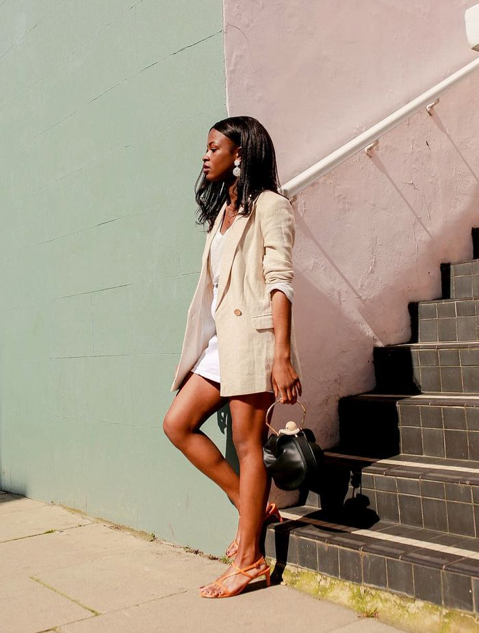 What to Wear in Summer: Eni in a linen blazer and denim mini skirt