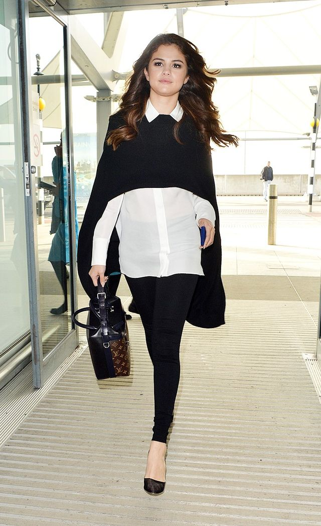 On Selena Gomez: Alice + Olivia Lolita Drop Hem Buttondown With Piping ($298) and leggings; Barrie Glamour poncho; Soebedar Shania Pumps ($557).
