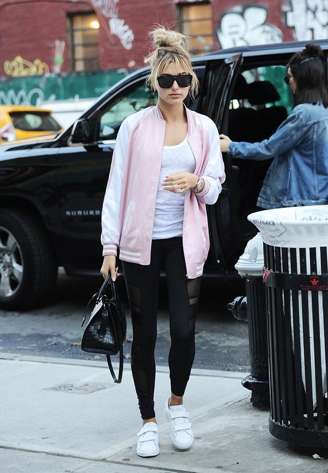 On Hailey Baldwin: Saint Laurent SL 87 Sunglasses ($182), Two-Tone Bomber Jacket ($2590), and tote; Lululemon leggings; Acne Triple Sneakers ($500).
