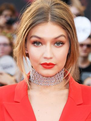 The Secret to Gigi Hadid's Perfect Coral Pout Is This $8 Lipstick