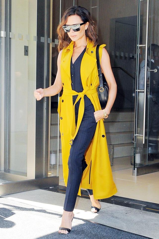 On Victoria Beckham: Victoria BeckhamD-Frame Acetate Sunglasses($450) andHalf Moon Leather Shoulder Bag($2500).
