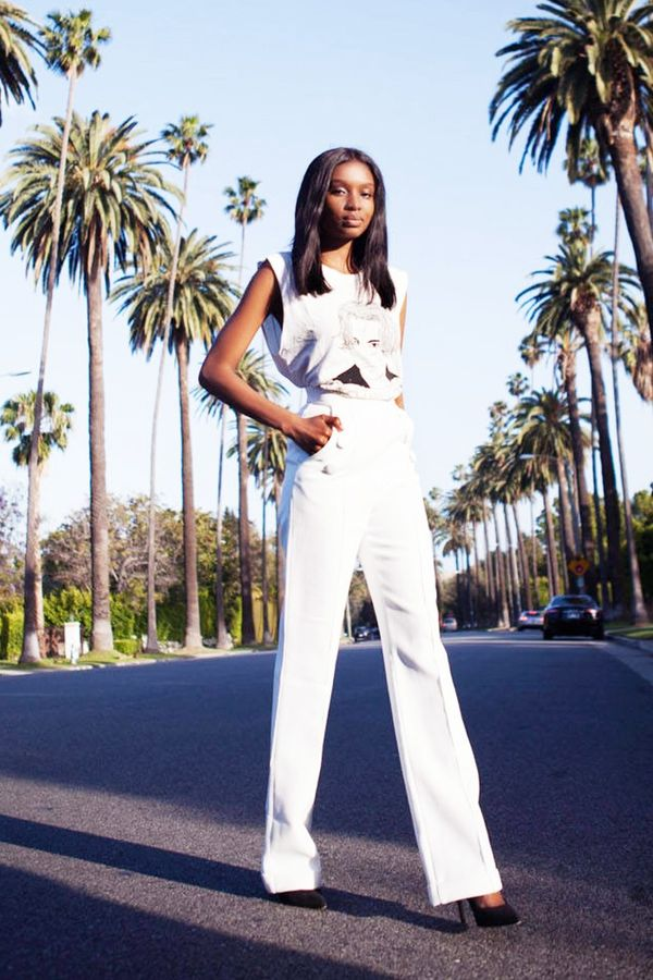 On Natasha Ndlovu:Stylestalker T-shirt; Misha pants; ASOS heels.
