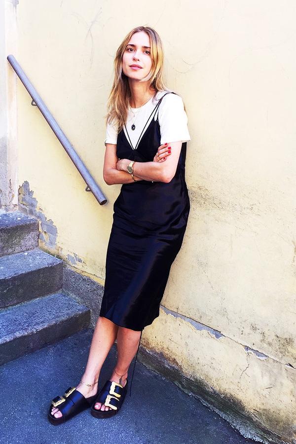 On Pernille Teisbaek: Filippa K Rugged Silk Tee($89); Alexander Wang dress; Céline Leather Mules($626).