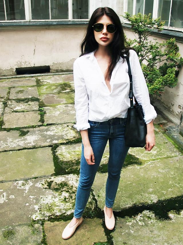 On Laura Matuszczyk: Calvin Klein shirt; Levi's jeans; Retrosuperfutre Lèon Sunglasses($269); Mongrei Zoe Bucket Bag(225); Balagan Opera Nude Shoes($116).