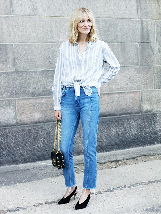 On Marie Hindkær Wolthers: Freequent shirt; Sandro jeans; Notabene Barbara Shoes($252); Jimmy Choo Petite Lockett Shoulder Bag($1151); Anni Lu Heart Line Necklace($505).