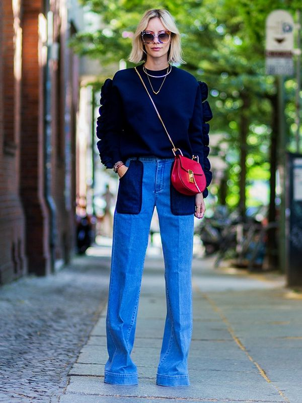 Style Notes: The patchwork denim bug has obviously spread across Europe—we love how Lisa Hahnbueck has paired her wide-leg jeans with subtly stand-out pieces like a Victoria Beckham...