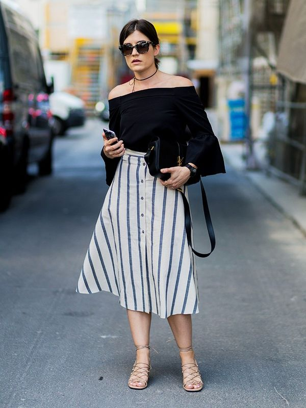 Style Notes:Carola Pojer's ASOS Button Through Midi Skirt in Natural Stripe(£32/£22) is a very versatile summer buy—she's wisely grounded the look for work with a...
