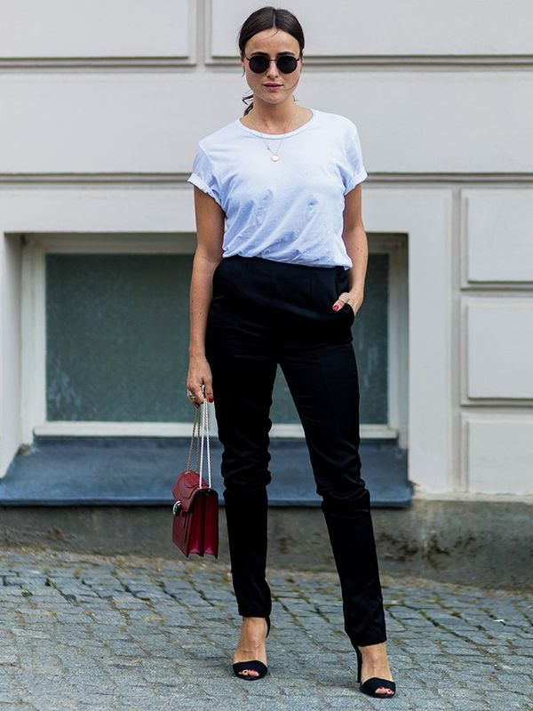 Style Notes:Lena Lademann convinces us there is nothing better than a white tee and black trousers—especially when they're accessorised with a Bulgari bag.