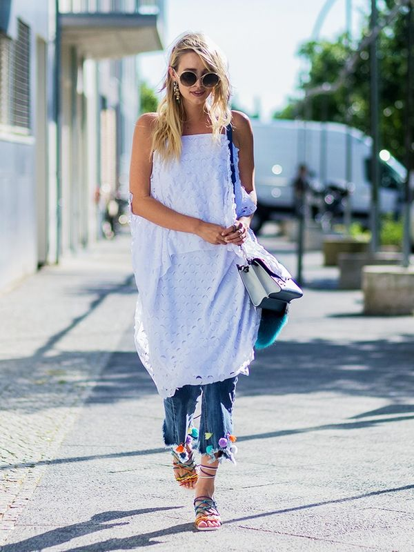 Style Notes: Who says you can't wear your favourite holiday clothes in the city? Layer a white dress over jeans and wear with bright sandals likeLeonie Sophie Hanne now.