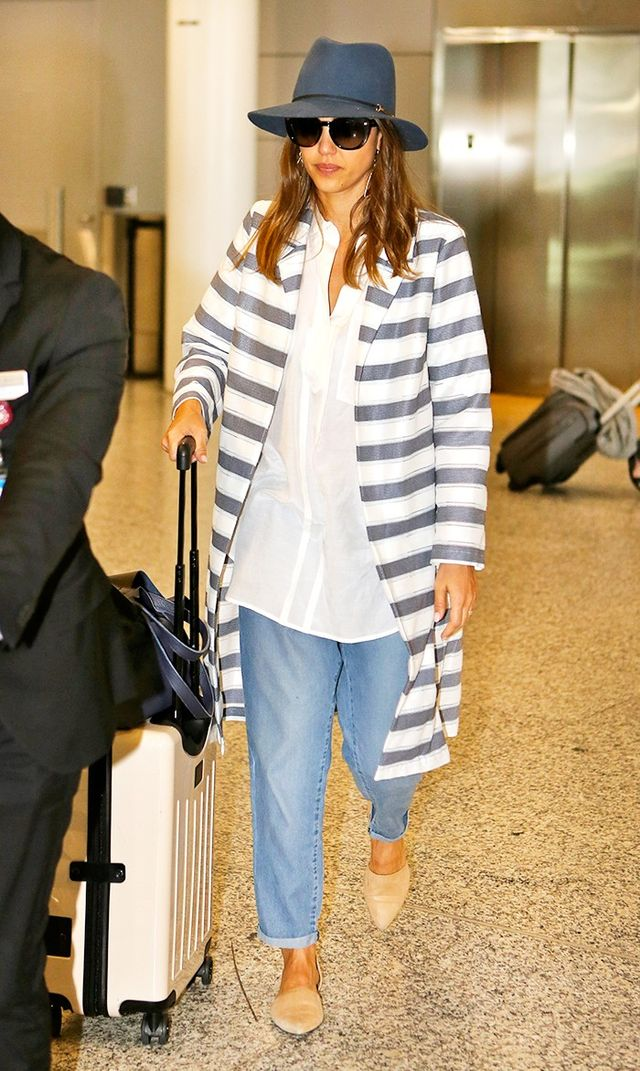 On Jessica Alba: Janessa Leone Sara Hat ($170); Jenny Kayne mules; Loms Carry-On Spinner ($695); Related Louisa Coat ($215).