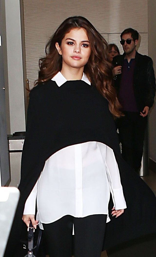 Selena Gomez was dangerously close to being swamped in this knitted cape but the exposed collar (and cropped style) keep the look crisp and sleek, just the way your winter wear...