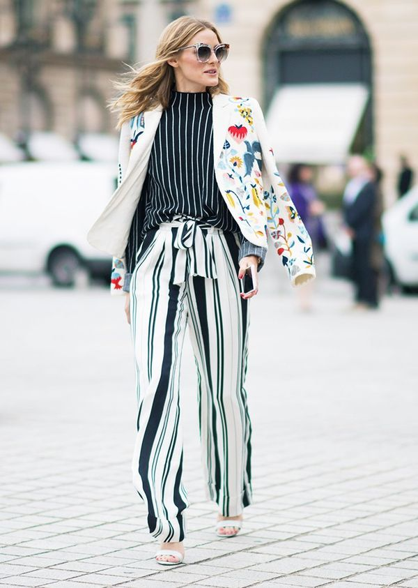 Style Notes: In true Olivia Palermo style, this is a perfect print-clash. The Schiaparelli jacket, Zara top and Chelsea28 trousers work in harmony thanks to a black-and-white base palette.