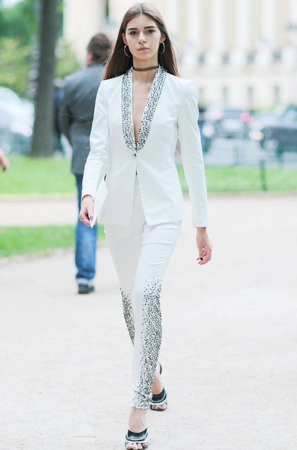 Style Notes: Another take on an increasingly popular trend—the white suit. The disco-ready gem embellishment puts this firmly in the couture realm of daywear.