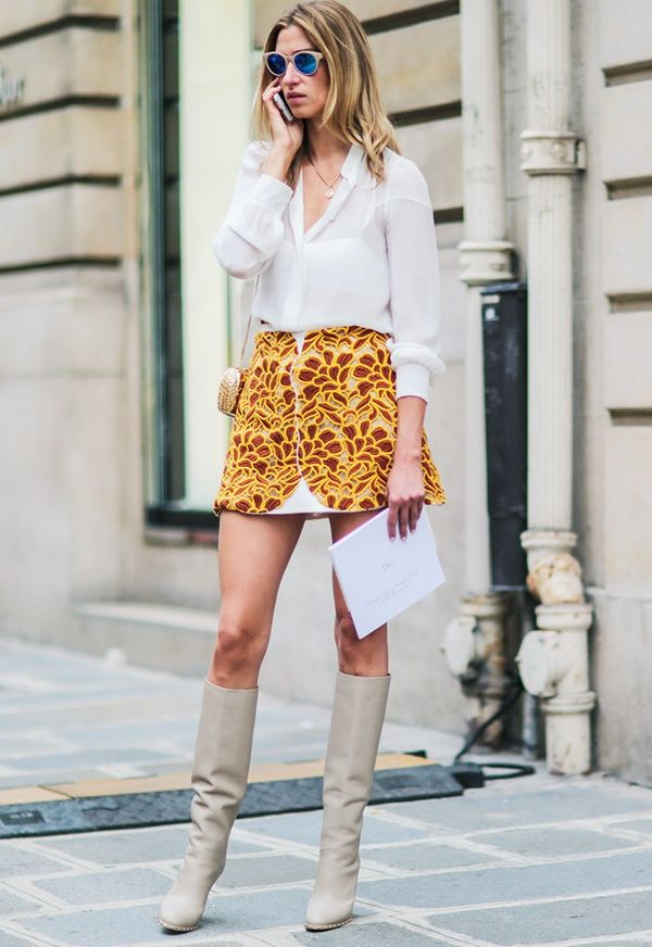 Style Notes: Lauren Remington-Platt's doing a very convincing 1960s go-go girl thing in those knee boots with bare legs.
