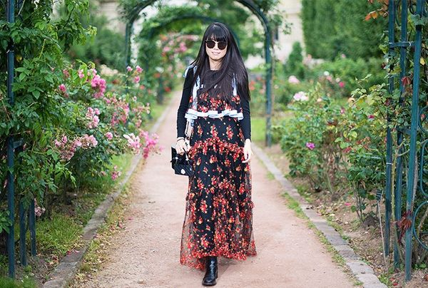 Style Notes: Yet further proof that dark floral dresses are a sound investment—you can wear them layered and with ankle boots whenever the weather takes a bad turn.