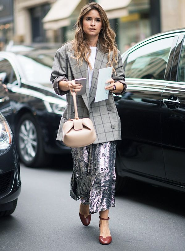 Style Notes: Miroslava Duma's party skirt meets business attire with a checked blazer.