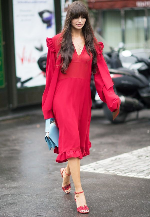 Style Notes: These billowing chiffon dresses are having quite a moment, but it's the unusual baby blue and lipstick red combination here that really catches the eye.