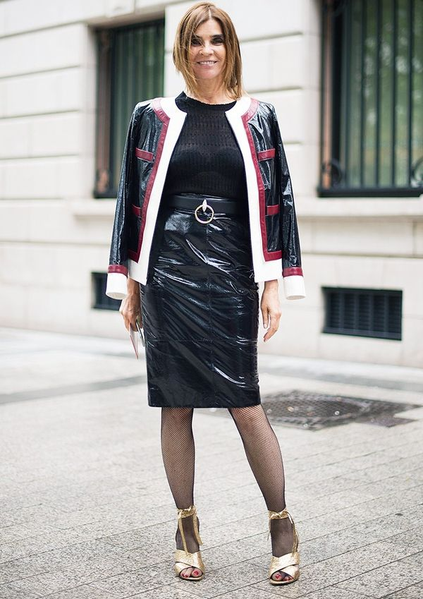 Style Notes: Carine Roitfeld loves a kinky combination, and her patent skirt suit, bondage belt, fishnet tights and lace-up shoes certainly fulfills. A demure knit balances the look out.