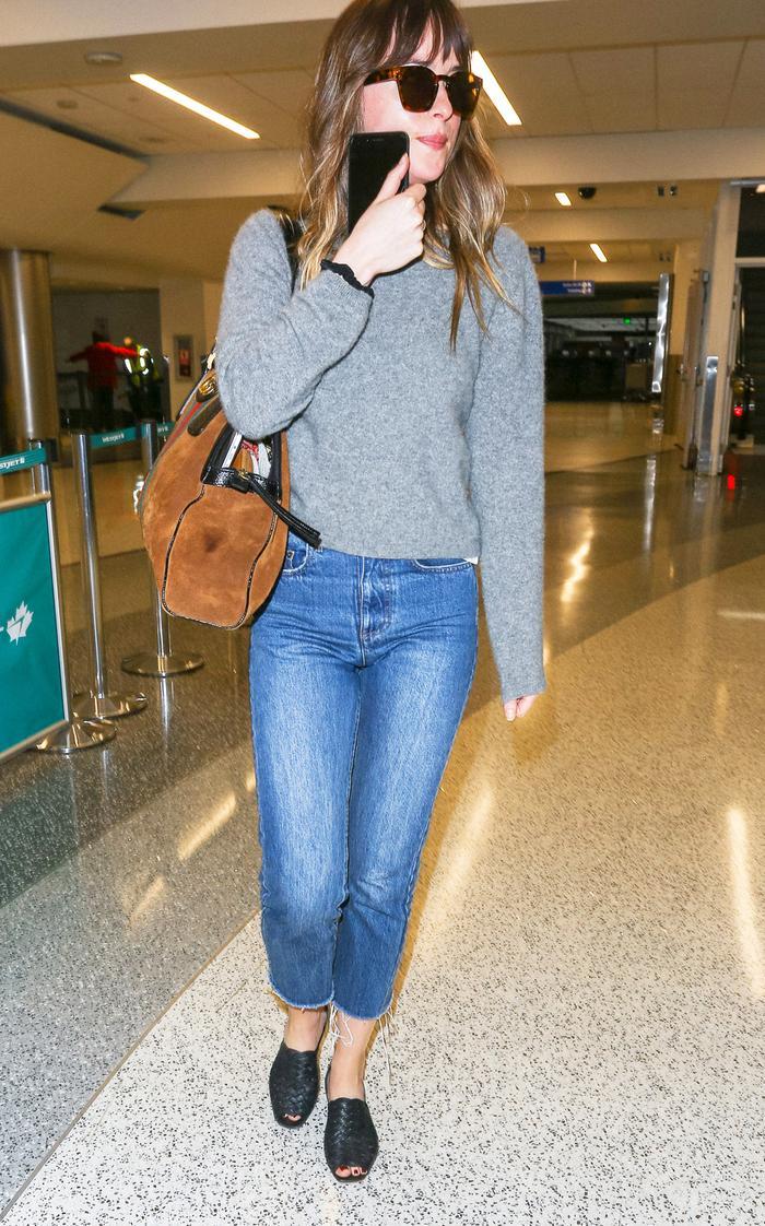 best travel outfits airport style: Dakota Johnson