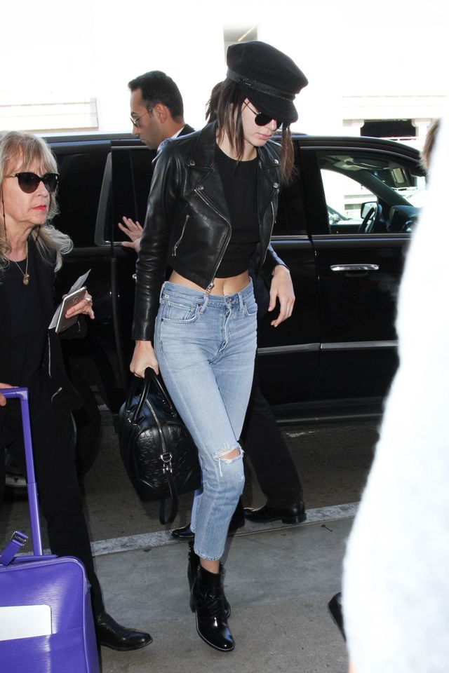 Paired with a cropped leather moto jacket and ripped high-waisted jeans, Kendall's cap complements her 'post-concert fashion-girl' vibe perfectly. Nothing says off-duty model...