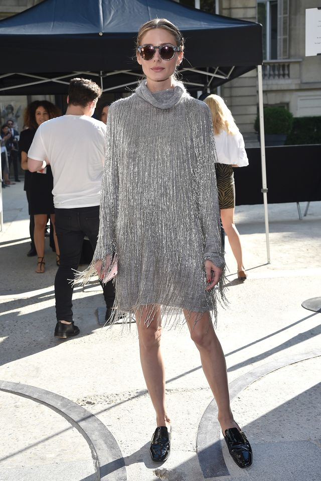 In thistasselled metallic mini, there's no stopping Olivia. Here, she was on her way to Valentino's Haute Couture show but we think this look is just as suited to an end-of-week wind down...