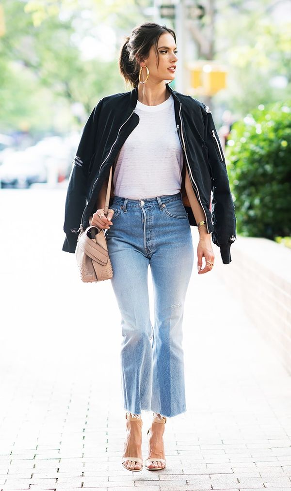 On Alessandra Ambrosio: Unravel Destroyed Twill Bomber Jacket in Black ($1690); Tod's Micro Wave Leather Tote in Nude ($1845); RE/DONE | Levi's The High Rise Wide Leg...