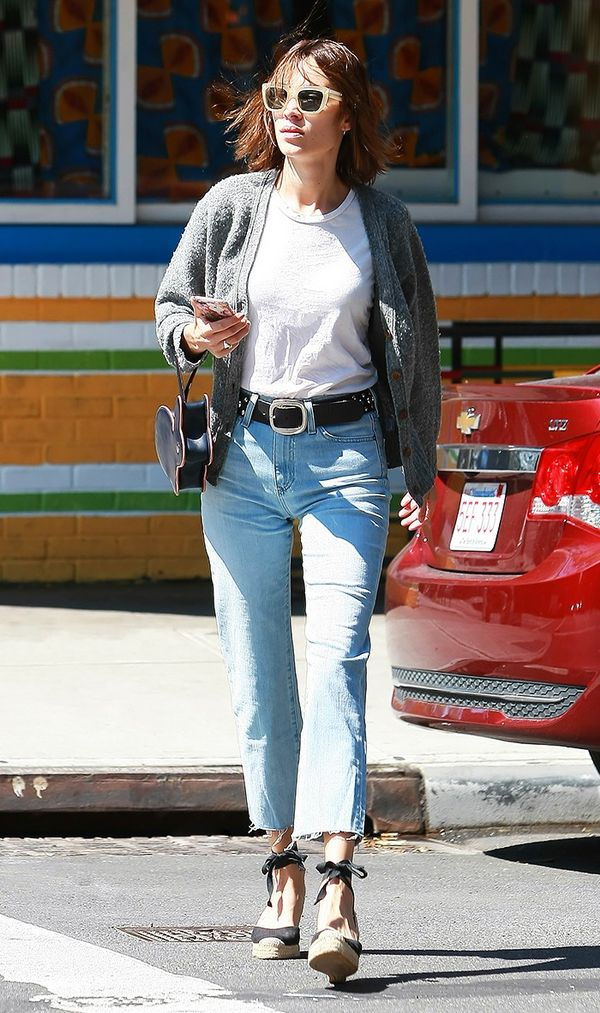 On Alexa Chung: Hillier Bartley Bunny Leather Clutch ($441); AG The Phoebe Vintage High Waist Jeans in Inviting Light ($215); Castaner Carina Canvas Wedge Espadrilles in Black ($125).