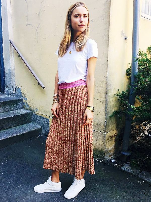 WHO: Pernille Teisbaek Style Tip:Lighten up a ribbed-knit skirt with a simple top and sneakers.