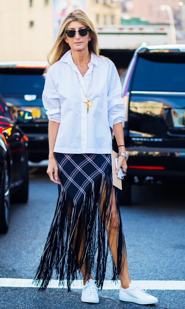 WHO: Sarah Rutson Style Tip: Snag a statement maxi skirt and wear an untucked white button-down on top. Add sneakers for good measure.