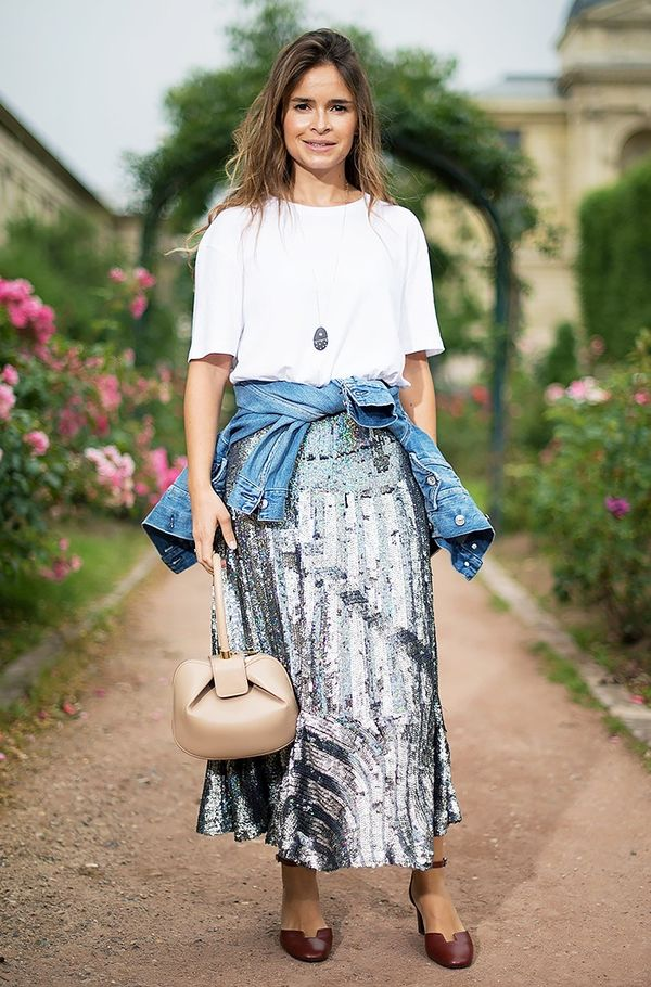 WHO: Miroslava Duma Style Tip:Dress down a sparkly skirt with a white T-shirt and denim jacket tied around the waist.
