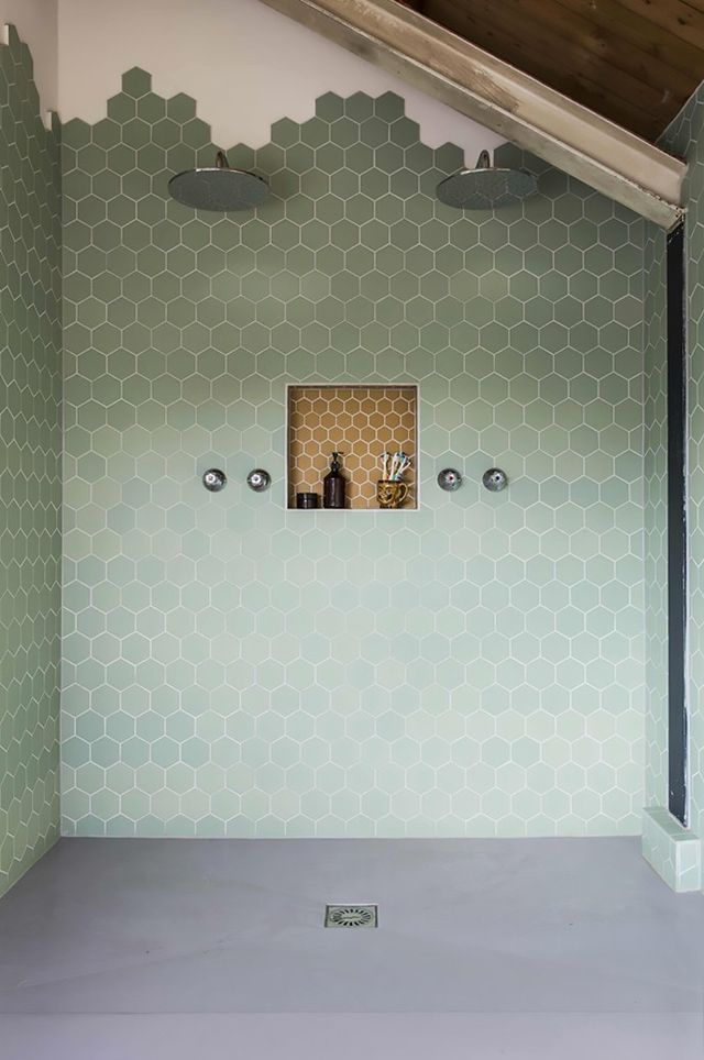 Not ready to renovate your floors? This gorgeous bathroom dabbles in the trend by gradually fazing out the hexagonal tiles towards the ceiling to make a honeycomb-like pattern. The best bit? You...
