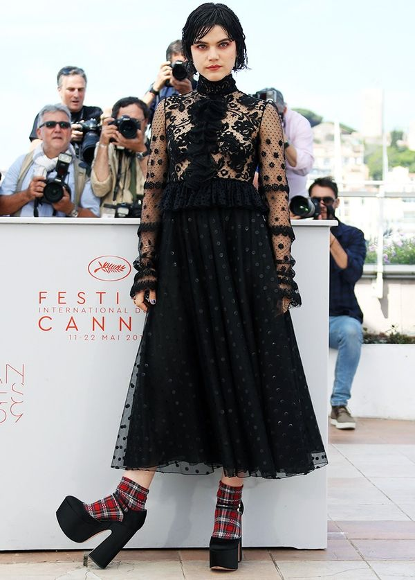 Style Notes: Very few other girls would wear a black lace dress in the sunshine, let alone a Giambattista Valli one with purposefully wet-look hair, tartan socks and giant platforms. We...