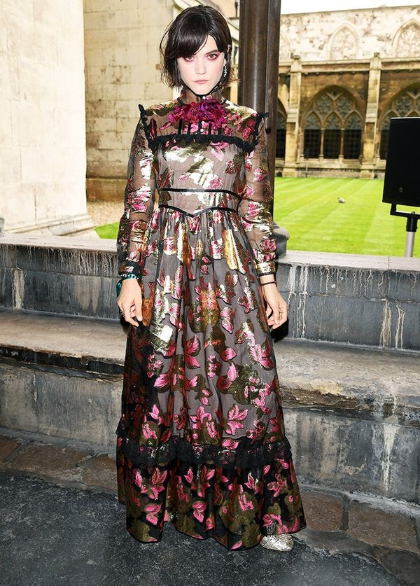 Style Notes: The costume drama of this Gucci gown is perfectly offset by a corsage.